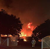 Lake, Isle of Wight, UK. 17th July, 2015. Firefighters from across the Isle of Wight are this morning tackling a large blaze at a Learning centre in Lake the former Broadlea Primary School which has been engulfed by flames. Fire crews were called to the scene at around 00:05 following reports of a fire, which is believed to have started in a mini bus before spreading to the nearby building. 6 Fire appliances and 30 Fire Fighters are currently on the scene. The building has been completely gutted by the fire, which has spread easterly with the wind. © jason kay/Alamy Live News - Stock Image - EXW5KG