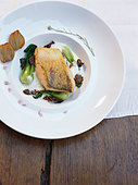 Fried zander with pak choi and mushrooms - Stock Image - BJK20J