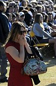 epa04228930 A student cries during a memorial event for the six UCSB students killed and 13 wounded in a shooting rampage in the college town of Isla Vista, at Harder Stadium at the University of California in Goleta, California, USA, 27 May 2014. The suspected gunman, 22-year-old student Elliot Rodger, killed six people and wounded 13 as he drove through the college town shooting as well as running over victims in his BMW car before he died from a self-inflicted wound. Over 18,000 people mainly students attended the memorial service.  EPA/MICHAEL NELSON - Stock Image - E1CHM5