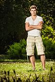 Man standing in field - Stock Image - CWWENE