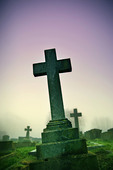 Photo of a cross in a graveyard - Stock Image - ACFWN5
