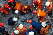 Jakarta, Indonesia. 31st Oct, 2014. Rescuers gather around the body of a victim during an operation in Jakarta, Indonesia, Oct. 31, 2014. It is believed that an archive building collapsed on Friday morning, causing four construction workers died, five workers seriously injured and two members of a rescue team slightly injured when searching victims. © Veri Sanovri/Xinhua/Alamy Live News - Stock Image - E9PG3F