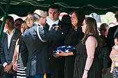 Tucson, Arizona, USA. 24th May, 2014. MELINDA BARRERAS (ed. note: without sunglasses), the wife of Command Sgt. Maj. MARTIN BARRERAS, receives the flag from her husband's casket during his interrment in Tucson, Ariz. Barreras was wounded earlier in May after his unit came under fire in Herat Province, Afghanistan and died May 13, 2014 in Texas. Barreras is the most recent U.S. serviceman killed as a result of enemy action in Afghanistan. © Will Seberger/ZUMAPRESS.com/Alamy Live News - Stock Image - E16PHB