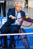 City Hall, London, UK. 24th November, 2014. Mayor Boris Johnsonwelcomes the world's best wheelchair tennis players with a game of mini tennis outside City Hall. The players are in London to compete in the NEC Wheelchair Tennis Masters 2014, being held at the Lee Valley Hockey and Tennis Centre, being held from 26 - 30 November. PICTURED: Mayor Boris Johnson rallies for wheelchair Tennis outside City Hall. © Paul Davey/Alamy Live News - Stock Image - EB1JNH