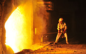 worker takes a sample at steel company - Stock Image - CPT6W4