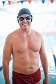 Man wearing swim gear at pool - Stock Image - CRKG56