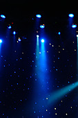 Colorful Stage Lights at a Theater with Copy Space - Stock Image - AJWPWK