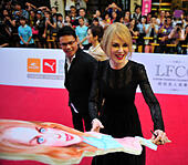 Haikou, China's Hainan province. 24th Oct, 2014. Australian actress Nicole Kidman (R) signs her autograph at the red carpet ceremony of the 2014 Mission Hill World Celebrity Pro-Am golf tournament in Haikou, capital of south China's Hainan province, Oct. 24, 2014. © Guo Cheng/Xinhua/Alamy Live News - Stock Image - E9BWC5