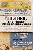 Drinks advertising, side of house, Larnaca, Cyprus - Stock Image - E15MNK