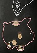 Chalk drawn hand dropping real pound coins into a chalk drawn piggy bank - Stock Image - CF4YAW