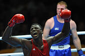 Glasgow, Scotland, UK. 29th July, 2014. Paul Schafer of South Africa (blue) and Efe Ajagba of Nigeria in the Mens Super Heavy (+91kg) boxing during day 6 of the 20th Commonwealth Games at the Scottish Exhibition Conference Centre on July 29, 2014 in Glasgow, Scotland. (Photo by Roger Sedres/Gallo Images/Alamy Live News) - Stock Image - E5FK7J