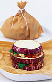 Aubergine parcels with diced mozzarella and peppers - Stock Image - BD5N6T