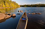 A solo canoe on Lake Alice in the Boundary Waters Canoe Area Wilderness, Minnesota, USA. - Stock Image - C1CGRM