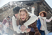 Friends enjoying snowball fight - Stock Image - CWJKMW