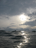 View of water and sky looking up from surface - Stock Image - B6TCT4