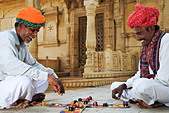 Two men playing a traditional Hindu game Chopar in front of the Siva Temple at Gadisar Lake - Stock Image - AGB46K