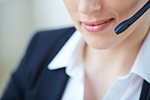 Part of face of young customer support representative - Stock Image - E254GE