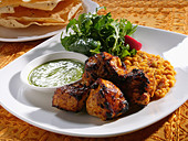 Close up of chicken tandoori entree - Stock Image - CBTFT4