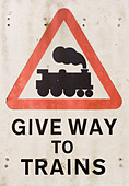 An old railway sign showing a steam train - Stock Image - ABF7W2