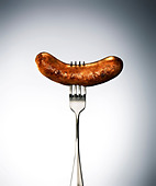 suasage on a fork - Stock Image - BFJFC9