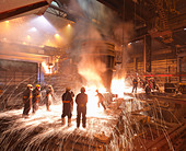 Workers With Molten Steel In Plant - Stock Image - BK979X