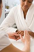 Woman having hands massaged - Stock Image - BCJPG3