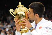 Wimbledon, UK. 12th July, 2015. The Wimbledon Tennis Championships. Gentlemens Singles Final between Novak Djokovic (SRB) and Roger Federer (SUI). Novak Djokovic (Ser) kisses the winners trophy as he defeats Roger Federer (Sui) © Action Plus Sports/Alamy Live News - Stock Image - EXECFH