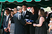 Tucson, Arizona, USA. 24th May, 2014. MELINDA BARRERAS (ed. note: without sunglasses), the wife of Command Sgt. Maj. MARTIN BARRERAS, receives the flag from her husband's casket during his interrment in Tucson, Ariz. Barreras was wounded earlier in May after his unit came under fire in Herat Province, Afghanistan and died May 13, 2014 in Texas. Barreras is the most recent U.S. serviceman killed as a result of enemy action in Afghanistan. © Will Seberger/ZUMAPRESS.com/Alamy Live News - Stock Image - E16PY1