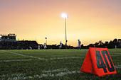 Football field at the 40th yard at night - Stock Image - BE3C3H