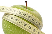 Diet concept - apple and measuring tape isolated on white - Stock Image - C2P6N3