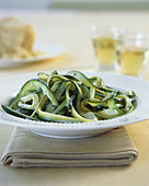 Strips of courgette with cream sauce - Stock Image - AF4DWY