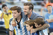 Rio De Janeiro, Brazil. 13th July, 2014. David Beckham poses with his sons before the final match between Germany and Argentina of 2014 FIFA World Cup at the Estadio do Maracana Stadium in Rio de Janeiro, Brazil, on July 13, 2014. Germany won 1-0 over Argentina after 120 minutes and took its fourth World Cup title on Sunday. © Liao Yujie/Xinhua/Alamy Live News - Stock Image - E4JYA0