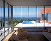 Brosmith Residence, Beverly Ranch, Los Angeles, California. Living area with view of swimming pool terrace. - Stock Image - ANEM87
