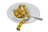 Tape measure with fork on plate cut out on white background - Stock Image - ABH9YM