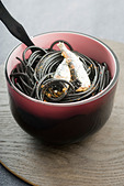 Black spaghetti with sardines and Espelette pepper - Stock Image - CBCFAF