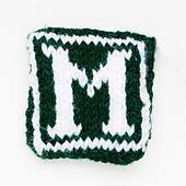 Knitted letter M woollen lettering. - Stock Image - ED87CD