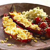 Stuffed red peppers with rice and tomatos on the vine - Stock Image - BXWBXW