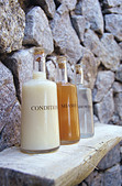 Three bottles with body care products - Stock Image - A5BYK2