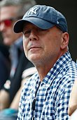 epa04388249 US actor Bruce Willis watches Kei Nishikori of Japan play Novak Djokovic of Serbia during their semifinals round match on the thirteenth day of the 2014 US Open Tennis Championship at the USTA National Tennis Center in Flushing Meadows, New York, USA, 06 September 2014. The US Open runs through 08 September, a 15-day schedule.  EPA/ANDREW GOMBERT - Stock Image - E78HNG