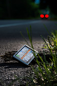 Broken GPS Thrown On To Side Of Road - Stock Image - DET3BN