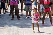 Mariel, Cuba, a little girl dancing on the street - Stock Image - DTCX68