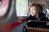 Smiling woman riding bus - Stock Image - CC9FK0