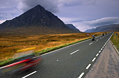 Motorbikes touring past Buchaille Etive mountain at Glen Coe in the Scottish Highlands UK - Stock Image - AY1WA7