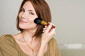 Woman applying makeup - Stock Image - BJP19M