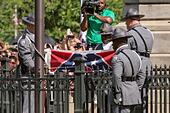 Columbia, South Carolina, USA. 10th July, 2015. South Carolina State police honor guard fold the Confederate flag at the State House during a ceremony to remove the symbol July 10, 2015 in Columbia, South Carolina. © Planetpix/Alamy Live News - Stock Image - EXBFYX
