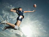 Low angle view of volleyball player jumping - Stock Image - AHYTJJ