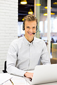Male calling computer desk video conference looking camera - Stock Image - DT48D0