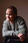 A gay woman with a shaved head - Stock Image - ACR07D