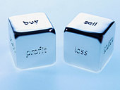 Close up silver cubes with sayings on them - Stock Image - BAXWE7