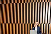 Portrait of smiling businesswoman using laptop - Stock Image - D2XG9F